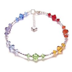 Swarovski crystal is renowned for its sparkle and quality. Seven colours of Swarovski have been used to correspond to the bodies seven Chakras. Between each Swarovski section there is a twisted Sterling silver tube bead and solid Sterling silver round beads.    This bracelet is 7.25 inches (18.5cm) in length and has the option to buy with or without an extender at no extra cost (both are shown in the photographs). The extender measures an inch which increases this bracelets wearable size to…