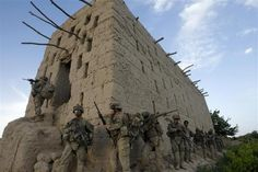 The 82nd in Afghanistan -- U.S. soldiers from 5-20 infantry Regiment attached to 82nd Airborne enter a barn while on patrol in Zharay district in Kandahar province, April 26, 2012.   REUTERS/Baz Ratner