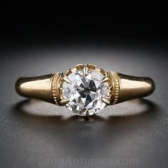 A bright-white, old mine-cut diamond, weighing 1.12 carats, sparkles and shines mostly unadorned from this elegantly understated original Victorian diamond engagement ring, hand-fabricated in rich 18 karat yellow gold, circa 1890.