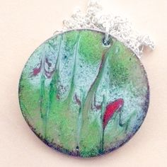 enamel pendant - round, scrolled white and re over green £7.50