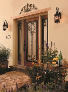 "Wrought Iron and Glass Front Entry Door Designs. This is ""Veranda"" #wroughtiron decorative door glass. Old-world, Mediterranean style."