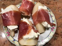 An afternoon snack of pear, cream cheese, and prosciutto.