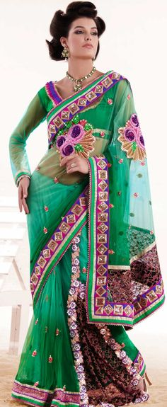 Be the cynosure of all eyes with this wonderful casual wear in flattering colors and combinations.   This emerald green net lehenga style saree is nicely designed with embroidered patch work is done with resham, zari, stone, cutbeads and lace work.   Beautiful embroidery work on saree make attractive to impress all.   This saree gives you a modern and different look in fabulous style.   Matching blouse is available.