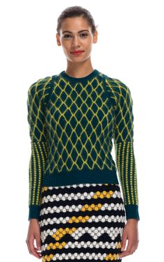 Digital Knit - Designer KENZO uses a jacquard knit for some of his designs. This garment shows the use of technology in knit creating complex patterns and bold colour combinations. KENZO creates exciting designs for a high end market. You can see you use of several different jacquard patterns in the top and skirt making a elegant overall design. https://www.kenzo.com/en/