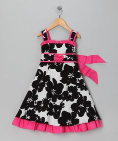 A vibrant print and ruffle trim make this fancy frock stand out. Made in Miami by industry experienced seamstresses, this age-appropriate design was created with childhood innocence in mind.100% cottonMachine washMade in the USA