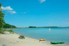 A small beach and picnic area on Power Island in Grand Traverse Bay near Traverse City.