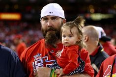 Jason Motte celebrates with his daughter Margaret after the Cardinals defeat the Los Angeles Dodgers 9-0 in GAME 6 of the NLCS.  10-18-13