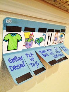 "Visual schedule with pull down flaps + magnets. When item is completed, close the flap, and the word ""done"" is on the outside. Now this is awesome for the kid who needs to be more interactive with his schedule!"