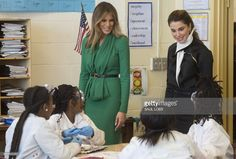 US First Lady Melania Trump (L) and Jordan's Queen Rania talk with fifth grade students as they dissect owl pellets in a science class at the Excel Academy Public Charter School in Washington, DC, April 5, 2017. / AFP PHOTO / SAUL LOEB        (Photo credit should read SAUL LOEB/AFP/Getty Images)