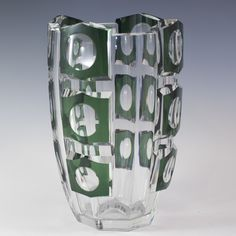 """DESCRIPTION:Marvelous crystal vase by Val St. Lambert embellished with geometric hexagonal cuts with circular interiors in triple layers. Finished with green hues along the embossed cuts. A few chips. CIRCA:20th Ct. ORIGIN:Belgium DIMENSIONS:H:9.27"""" Diameter:6.25"""""""