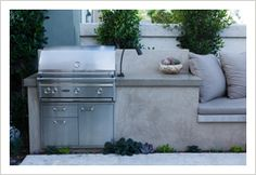 Idea for built-in bbq with attached seating - that continues on the retaining wall  Garden Studio Design