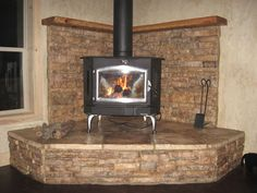Wood Stove Design Ideas painting wood stove google search Buck Stove On Large Stone Corner Hearth