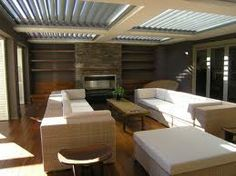Amazing outdoor entertainment area - love the skylights in the roof with the blinds to open or close