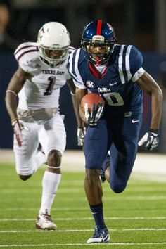 Ole Miss Football - Rebels Photos - ESPN OXFORD, MS - OCTOBER 12: Wide receiver Vince Sanders #10 of the Ole Miss Rebels is chased downfield by defensive back De'Vante Harris #1 of the Texas A&M Aggies on October 12, 2013 at Vaught-Hemingway Stadium in Oxford, Mississippi. At halftime Texas A&M leads Ole Miss 14-10. (Photo by Michael Chang/Getty Images)