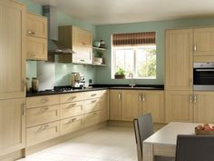 Like the colour of this wood effect but would want real wood. Tulsa - Oak Effect Shaker kitchen | Wickes.co.uk
