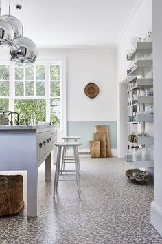 How to design a kitchen: light and airy kitchen with white and blue colour blocked walls, open shelving and textured flooring