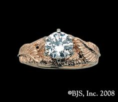 Can I just say that I'd be totally okay with this as an engagement or wedding ring? It's the Ring of Adamant or Nenya from LOTR. Given to Galadriel, the ring represents protection. How ballin' would that be?