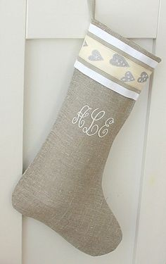Christmas stocking is made from pure organic linen burlap fabric. Stocking fully lined with white cotton. Hanging made from linen ribbon. Linen