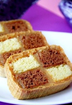 I love making this for the Holidays, because of the quantity, and everyone loves it. Sponge cakes rolled into wafer sheets, and tied togeth...