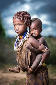 Two siblings in tribal village of south OMO Valley, the little boy was little fright with the strobes but as soon as he got to try it him self it´s was all ok, but i find this photo very emotional.