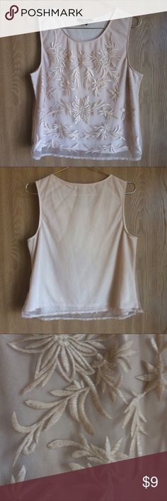 Forever 21 Floral Lace Top A beautiful top in a creme color with lace. The top has a layer of solid material and on top is a light lace material. Perfect for layering and greeting the warmer weather! Forever 21 Tops Tank Tops