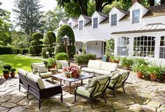 Woven wicker furniture and European antiques are seamlessly sprinkled throughout the gardens. Click through for more gorgeous garden photos and gardening decor ideas.