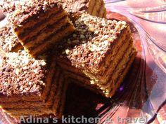 Reteta culinara Foi fragede cu miere si crema de ciocolata, nuca si rom din categoria Prajituri. Specific Romania. Cum sa faci Foi fragede cu miere si crema de ciocolata, nuca si rom