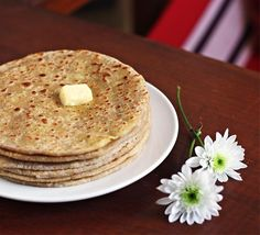 Extremely popular with North Indians, these are best eaten with chilled yogurt and your favourite pickle or chutney. Want to be naughty? Aaloo parathas taste delicious with fresh, thick cream or a knob of unsalted, home-made butter!