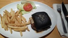 Black lamb burger served with fried rice.. damn so delicious.. that bun is really soft.. Wine & Meat.Co PIK