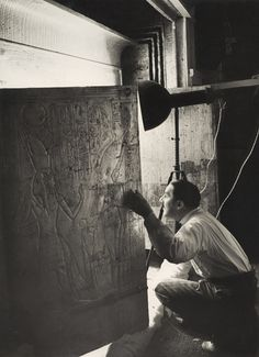 Howard Carter Looking through the Open Doors of Tutankhamun's Second Shrine. January, 1924  [::SemAp FB || SemAp G+::]