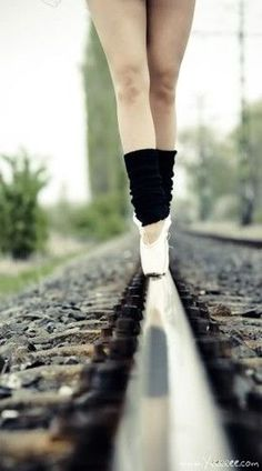 A ballerina on the wrong side of the tracks? I dunno what the story is but there's something there.