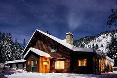 The first day of Christmas homes: A snowy cabin beneath glittering stars.