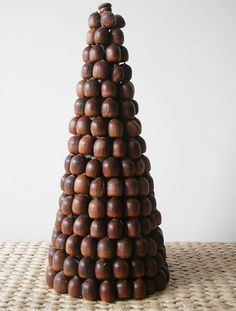 Natural handmade Christmas Craft idea using acorns. Wow, love this and for the base you can use one of our polystyrene or cardboard cones. Find them at www.craftmill.co.uk