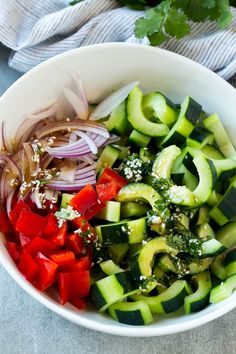 Sliced cucumbers, red peppers and onions with Asian dressing.