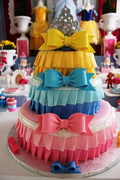 Disney Princess cake, each tier represents each Disney Princess' skirt...@Vicky Lee Lee Lee Lee Lee Lee Herring this would be a cute diaper cake for a little Princess!!!