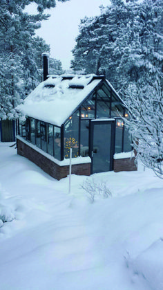 Snow and cold in northern Sweden. Inside the double glass Cape Cod Orangery it is 20 degrees above zero when the fire is crackling in the stove. http://garden-greenhouse.se/ #gardeninginthecity