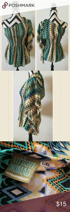 Tribal one sleeve blouse Beautiful colors and will look great year round.  Worn once, purchased at Earth Bound.   Elastic waist accommodates your body and figure. urban nomad Tops
