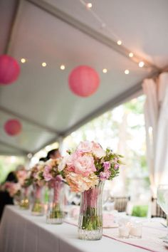 Put a little vase at each bridesmaid's seat for them to keep their boquete in while they're dancing! It'll keep the flowers nice and fresh, and help create some pretty pics!