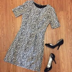 Black and White Animal Print Dress Comfortable dress from H&M. Fabric is a little stretchy. Looks cute with tights or leggings. H&M Dresses Midi