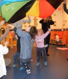 """Under the SEA (parachute) - game. """"The Sea is BIG The Sea is Cold The Sea is Silent The Wind starts to Blow (kids go under the parachute) The waves start to come. woosh woosh woosh (making sounds of wind and sea)"""" Under The Sea Games, Under The Sea Theme, Gross Motor Activities, Movement Activities, Preschool Arts And Crafts, Preschool Activities, Music Classroom, Preschool Classroom, Parachute Games"""
