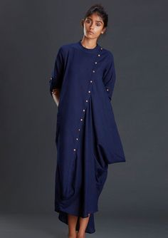 """Handwoven ooch neech blue dresses MTBONA This handwoven navy blue ooch neech dress is designed to make you look more classy and stylish *Chinese collared *buttoned down draped long and short dress *beautiful cowl on the side *Pockets and Turn up sleeves with wooden buttons for closure *Product length-53"""""""