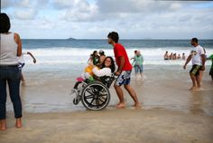 Pilgrim gets push down shoreline on Copacabana beach during World Youth Day  A pilgrim in a wheelchair gets a push down Copacabana beach at World Youth Day in Rio Janeiro July 26. (CNS photo/Tyler Orsburn)