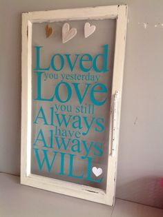 Old window with vinyl saying.