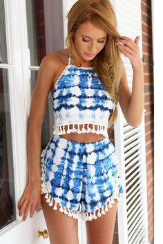Tie Dye Two Piece Set - The hot weather has got women everywhere stripping down to their bikinis, but what about when you want to head out and stay a little bit more covered? The hottest trend lately is a cute matching set. This Tie Dye Two Piece Set is adorned with tiny white tassels, which sway as you walk. #tiedye