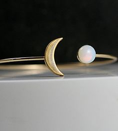 Crescent moon bangle with genuine vintage opal stone