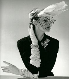 White Hat with Swan Feathers (Jacques Fath), 1951. Silver gelatin by Willy Maywald