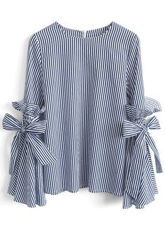 Gotta earn your stripes, babe, and there's no better way to own them than this dramatic Charisma top with bell sleeves, ruffles and self-tie bows.  - Bell Sleeves with Self-tie bowknot and ruffles - Spilt cuffs - Concealed back zip closure - Not lined - 65% Polyester, 35% Cotton - Hand wash  Size(cm)Length Bust Shoulder Sleeves XS/S       61    90    37      58 M/L        62    94    39      59 XL         63    98    41   ...