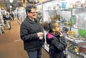 Abby Michael, 8, and her grandmother, Lynn Cox, look over the thousands of antiques and collectables for sale at the Heart of Ohio Antique Mall. According to the two shoppers they try to visit Heart of Ohio every weekend.