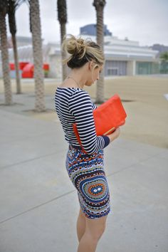 Courtesy of Cupcakes and Cashmere. Emily Schuman always knows how to classily mix patterns for unique style. jealousss