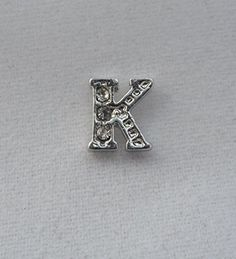 Crystal Letter K Initial Floating Locket Charm / Add to Your Origami Locket Float My Charms http://www.amazon.com/dp/B00HY1EOCS/ref=cm_sw_r_pi_dp_VLAOub1WBV7T8